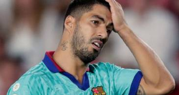Suarez accused of cheating on Italian language test